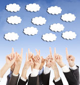 Group of business people hands point upward cloud — Stock Photo