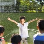 Little boy Punishment for water gun spray to wet body — Stock Photo #49751859