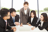 Business female manager briefing all colleagues in office — 图库照片