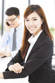 Young business woman with colleague in office — Stock Photo