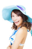 Young woman swear bikini suit and a sun hat — Stock Photo