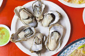 Delicious and nutrition sea food  ,barbecue Oysters with mustard — Stock Photo
