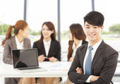 Business male manager with teams in the office — Stock Photo