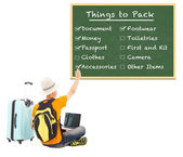 Young backpacker check things to pack on blackboard  — Stock Photo