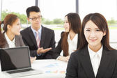 Business female manager with teams in the office — Stock Photo