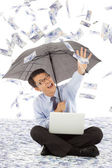 Happy business man stretch his hand to grab money — Stock Photo