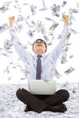 Business man making a successful pose with money rain background — ストック写真
