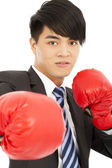 Business man ready to fight with boxing gloves — Stockfoto