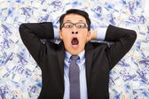 Excited  business man lying on the new taiwan dollar — Stock Photo