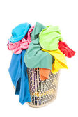 A pile of colorful and mess clothes in the basket — Stock Photo