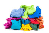 A pile of colorful clothes on the floor — Stock Photo