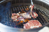 Closeup of meat on a grill or barbecue — 图库照片