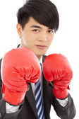 Business man sneer  and ready to fight with boxing gloves — Stock Photo
