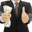 Businessman clench us dollars and thumb up — Stock Photo