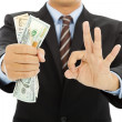 Businessman grasp us dollars with ok gesture — Stock Photo