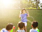 Little girl Punishment for water gun spray to wet body — Foto de Stock
