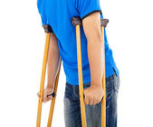 Close up of young man on crutches. white background — Stock Photo