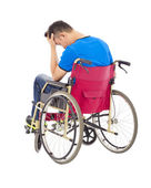 Depressed  and handicapped man sitting on a wheelchair  — Stock Photo