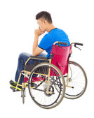 Handicapped man sitting on a wheelchair and thinking — Foto de Stock