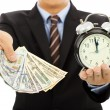 Businessman holding money and clock. time is money concept — Stock Photo #50927465