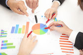 Business people looking at report and analyzing chart — Stock Photo