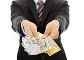 Business man holding us dollar cash. isolated on white — Stock Photo