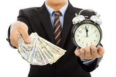 Businessman holding money and clock. time is money concept — Stock Photo