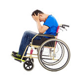 Upset  and handicapped man sitting on a wheelchair  — Stock Photo