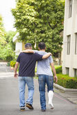 Friend helping brothers or patient  to walk without crutches  — Stock Photo
