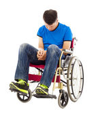 Frustrated handicapped man sitting on a wheelchair  — Stock Photo