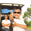 Cool boy thumb up and father across arms with car — Stock Photo #51203389