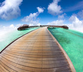 Beautiful maldives  beach and water villa with fish-eye lens — Stock Photo