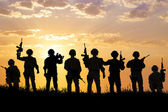 Silhouette of  Soldiers team with sunrise background  — Stock Photo