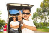 Cool boy thumb up and father across arms with car — Stock Photo