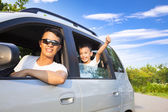 Happy little boy with father sitting in the car — Stock Photo