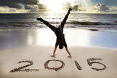 Happy new year 2015 on the beach with sunrise — Stock Photo