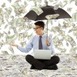 Young business man holding a umbrella with dollar rain — Stock Photo #51338737