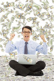 Business man make a victory gesture with money rain — Stock Photo