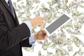 Business man touching tablet with money rain — Stock Photo