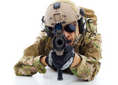 Soldier with rifle and lying on floor over white background — Stock Photo