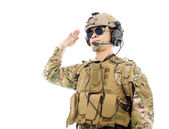 Soldier in military uniform  saluting over white background — Stock Photo