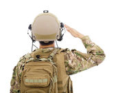 Closeup of Soldier in military uniform  saluting — Stock Photo