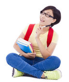 Asian young student girl sitting on floor  with a laptop — Stock Photo