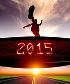 Happy new year 2015.runner jumping and crossing over matrix  — Stock Photo