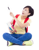 Beautiful student asian girl holding pen and sitting on floor — Stock Photo