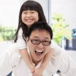 Happy asian family. father and little girl — Stock Photo #5490092