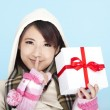 Winter portrait of a smiling woman with a gift box — Stock Photo #7551330