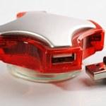 Four port red USB hub — Stock Photo
