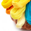 Colored threads for needlework in the basket — Stock Photo #16851219