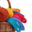 Colored threads for needlework in the basket — Stock Photo #16851273